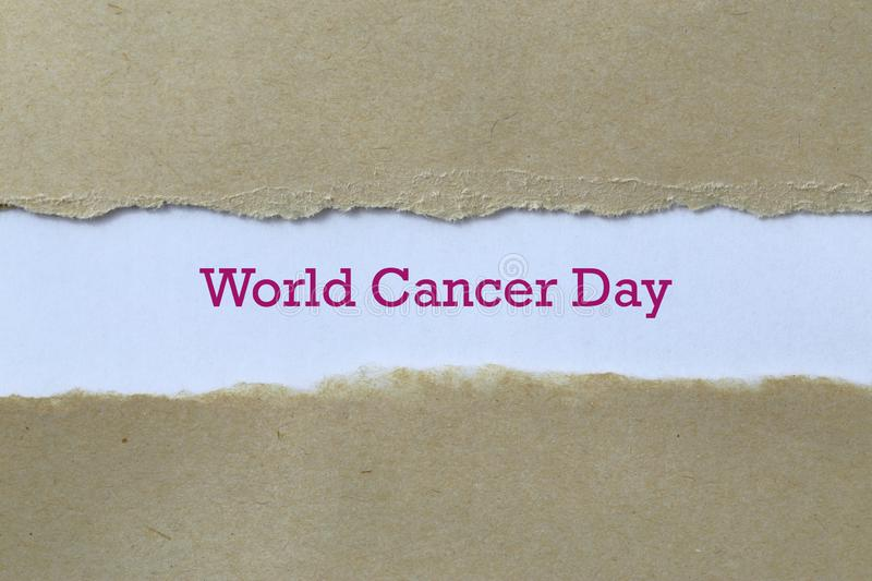World cancer day on paper. World cancer day word on paper stock images