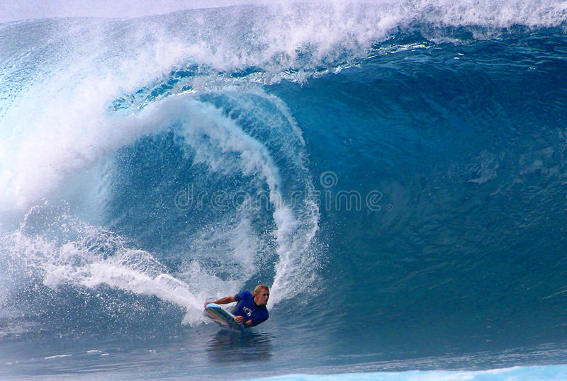 World Champion Bodyboarder, Jeff Hubbard. Pro Bodyboarder Jeff Hubbard riding a big wave while surfing at the Banzai Pipeline on the North Shore of Oahu, Hawaii royalty free stock images