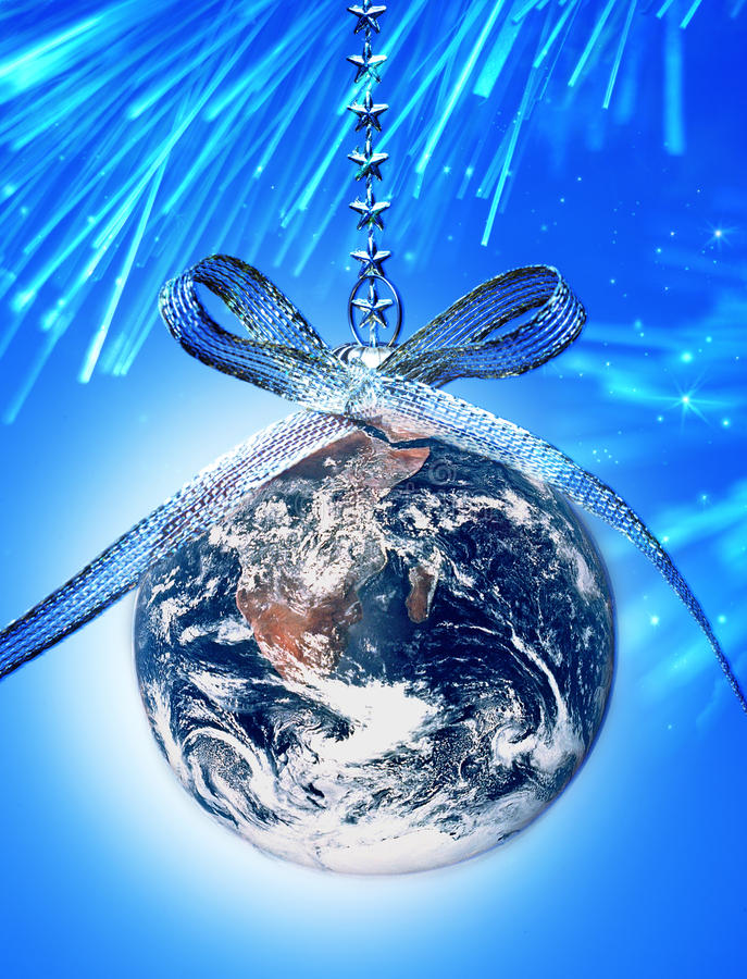 World Christmas Globe Earth. The earth as a christmas ornament with sky, stars and tree in the background