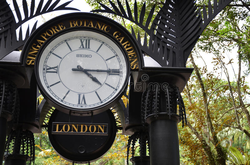 World clock near orchid garden in Singapore Botanic Gardens. SINGAPORE - JAN 15, 2016: World clock near orchid garden in Singapore Botanic Gardens. The tropical stock images
