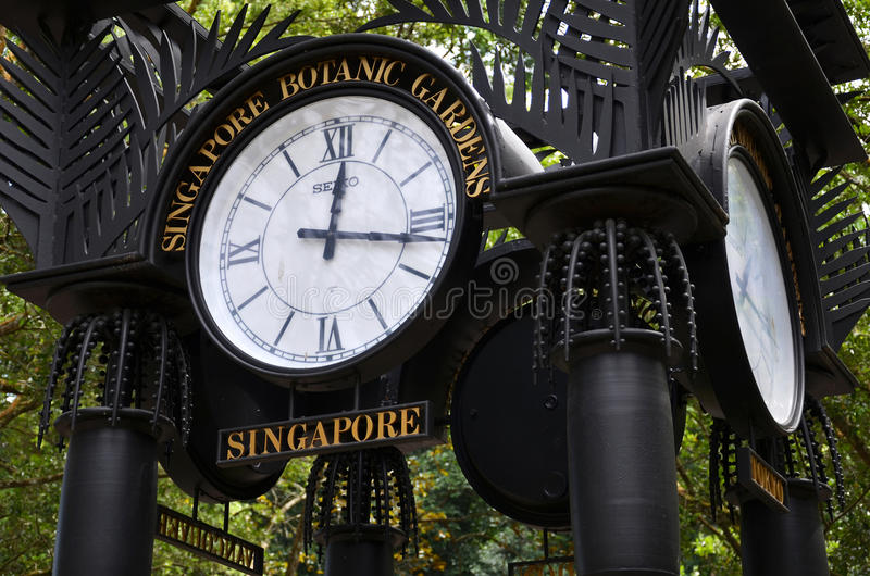 World clock near orchid garden in Singapore Botanic Gardens. SINGAPORE - JAN 15, 2017: World clock near orchid garden in Singapore Botanic Gardens. The tropical royalty free stock photos