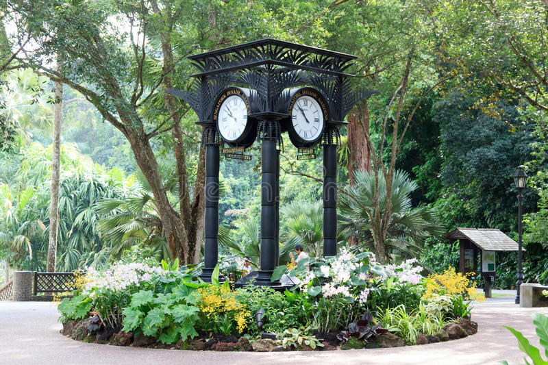 World clock near orchid garden in Singapore Botanic Gardens. Singapore Botanic Gardens is a tropical garden honored as a UNESCO World Heritage Site royalty free stock photography