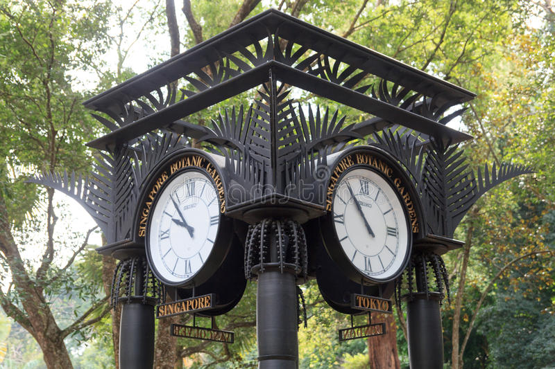 World clock near orchid garden in Singapore Botanic Gardens. Singapore Botanic Gardens is a tropical garden honored as a UNESCO World Heritage Site stock photography