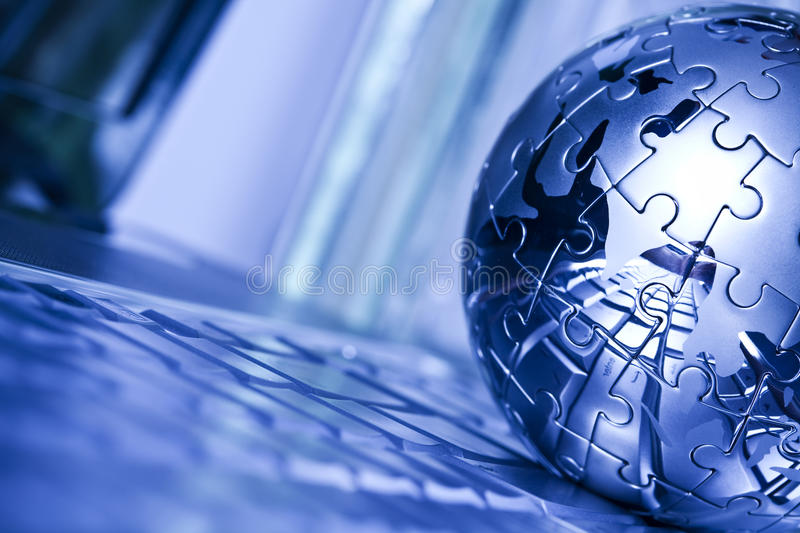 World and computer. Notebook & puzzle earth chrome globe royalty free stock photos