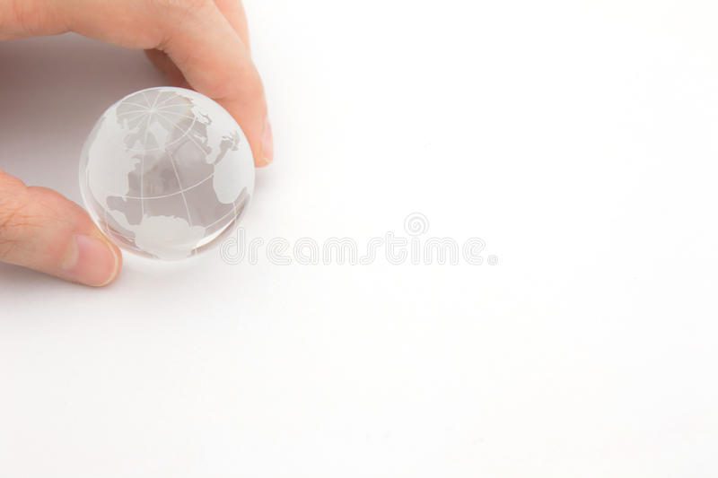 World connected. Social network concept. Closeup of a glass globe holding in hands. World connected. Social network concept stock photography