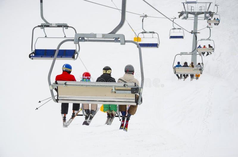 World cup ski centar, chair ski lift elevator Bansko Bulgaria. Chair ski lift elevator lifting people on the mountain ski slope, Bansko, Bulgaria ski centre royalty free stock photography
