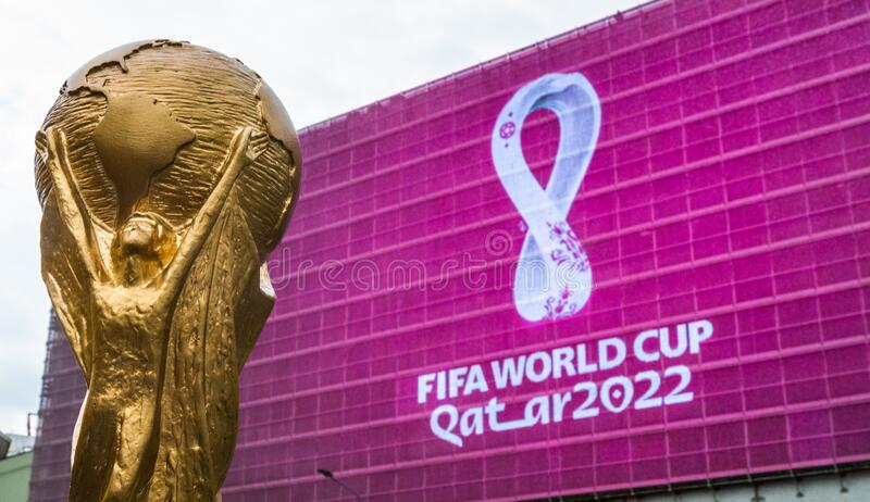 World Cup trophy. 4 September 2019, Moscow, Russia. Copy of world cup trophy on background logo of the FIFA world Cup 2022, which will be held in Qatar, on a stock photo