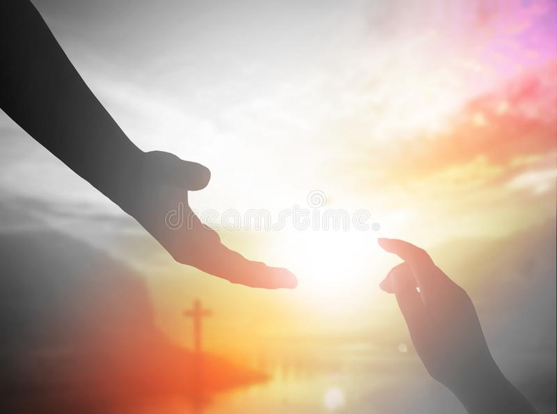 World Day of Remembrance: God`s helping hand. Background image for the church office: The Cross symbol of christian and Jesus Christ help hand stock photography