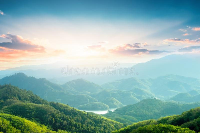 World Environment Day concept: Green mountains and beautiful sky clouds under the blue sky royalty free stock images