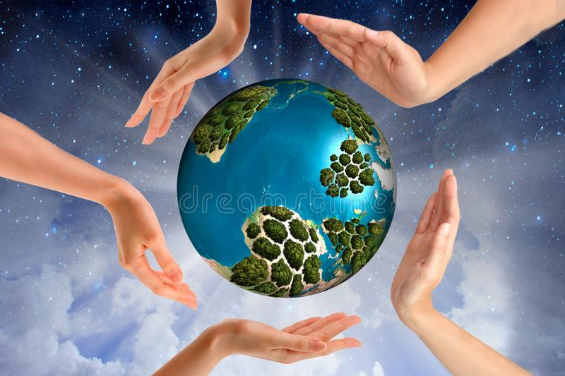 World environment day concept: human hands holding big growth plant and earth globe over green spring background stock images
