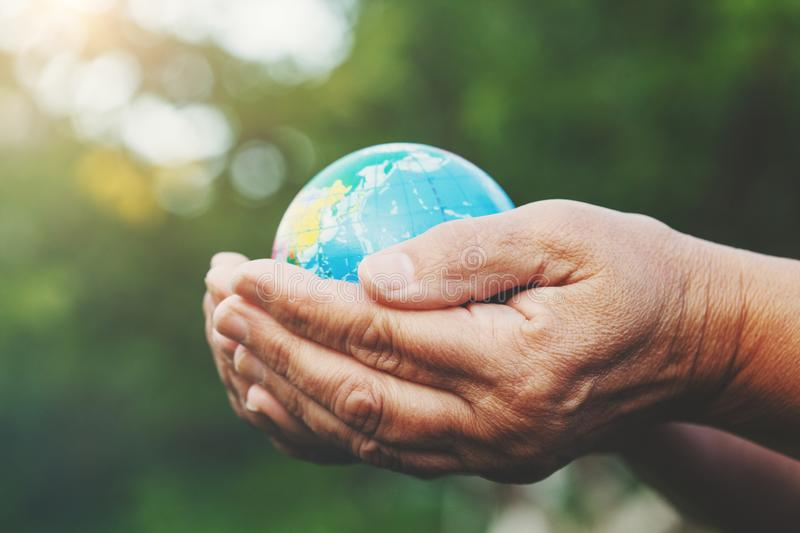 senior woman`s hands holding earth globe royalty free stock image