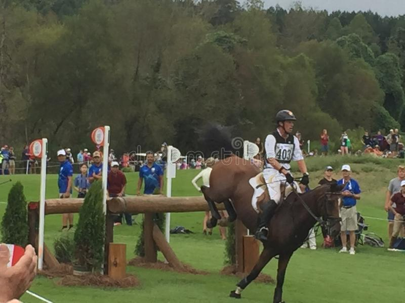 2018 world Equestrian games - eventing cross country day water complex New Zealand rider. WEG hosted by Tryon International Equestrian Center in Mill Springs royalty free stock photos