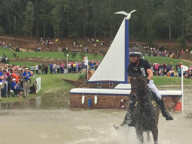 2018 world Equestrian games - eventing cross country day water complex New Zealand rider. WEG hosted by Tryon International Equestrian Center in Mill Springs stock images