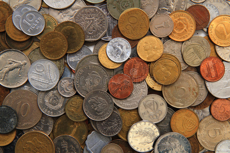 World and eruopean coins background royalty free stock photo