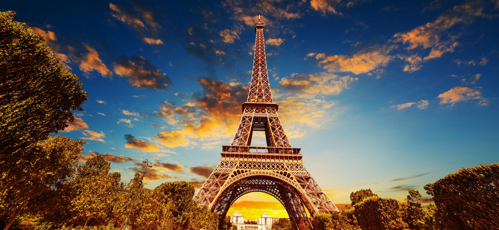 World famous Eiffel tower under a colorful sky at sunset royalty free stock image