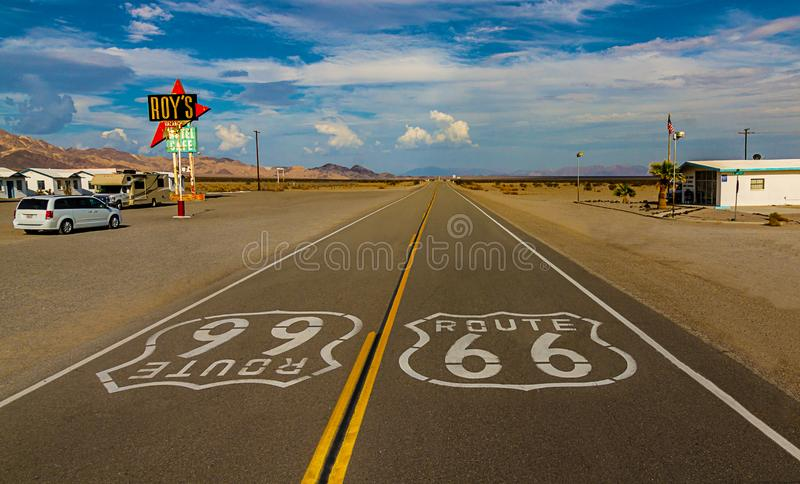 World famous and historic Route 66 signs on road at iconic Roy`s Motel and Cafe in Amboy, California royalty free stock photo