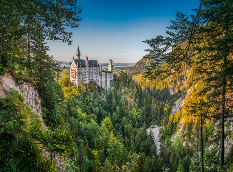 World-famous Neuschwanstein Castle in beautiful evening light, Germany. Beautiful panoramic view of world-famous Neuschwanstein Castle with steep poellat canyon stock photography