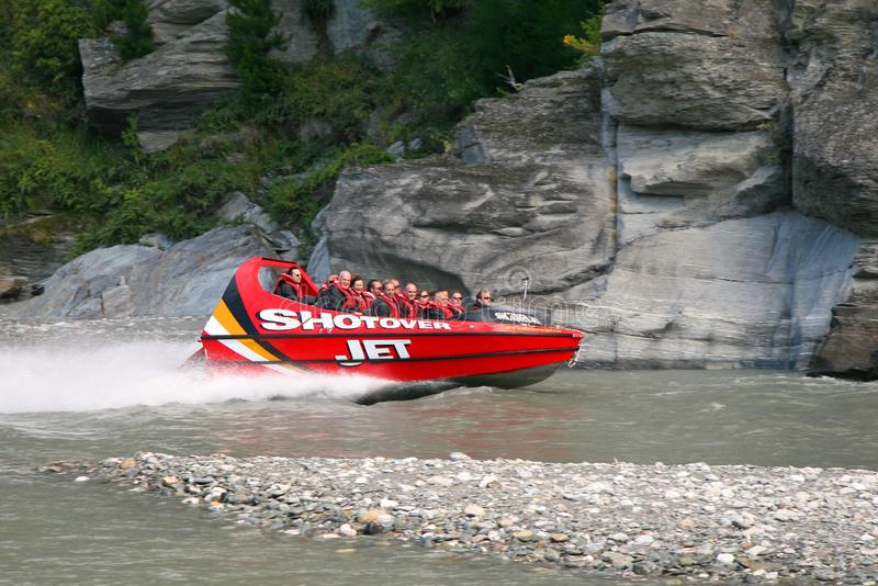 Queenstown, New Zealand - February 9, 2007: The world famous Shotover Jet boat thrills tourists down the Shotover river, South Isl royalty free stock photo