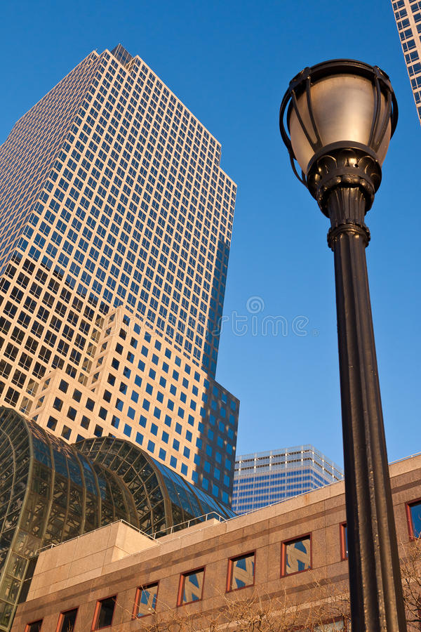 World Financial Center New York City. The golden sunset tones at the World Financial Center, Manhattan Island, New York City and a historical iron street lamp royalty free stock photos