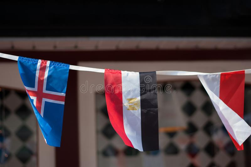 World global flags in macro outside. The cafe stock images