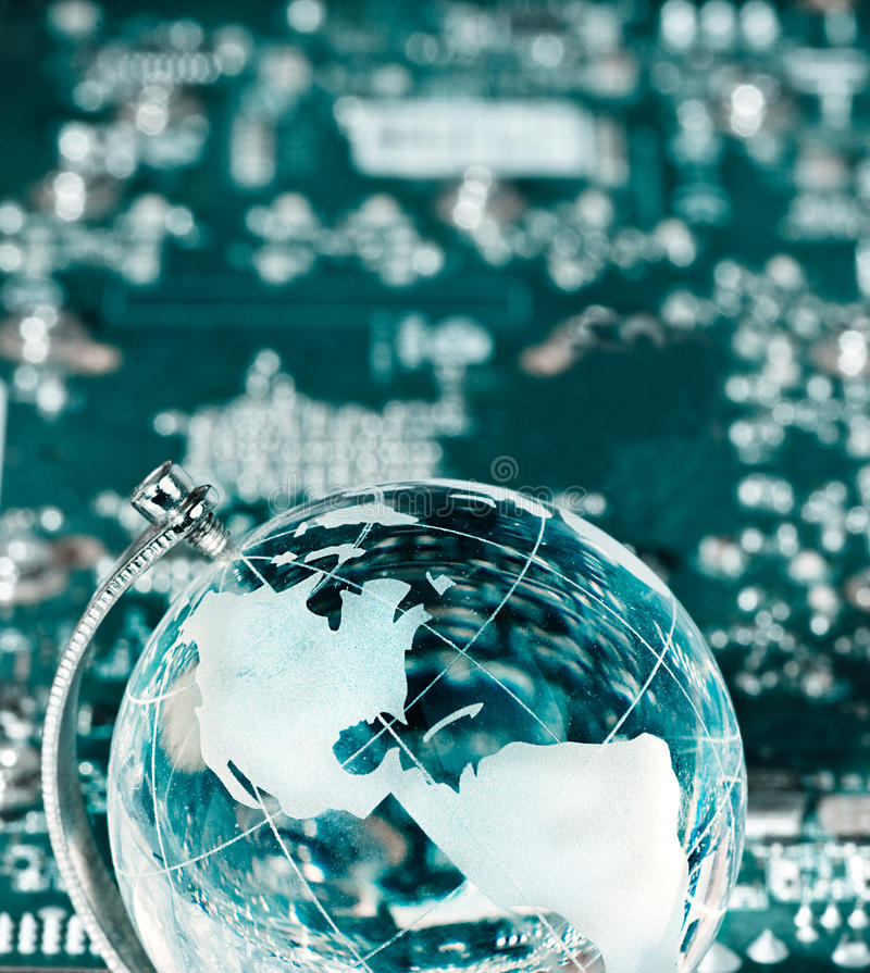 World globe with integrated technology elements stock photo