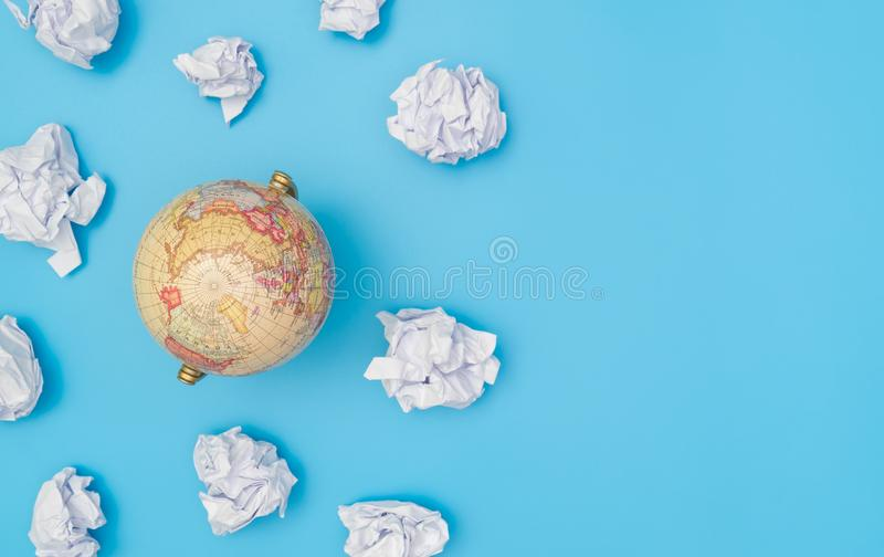 World globe in paper cloud stock photos