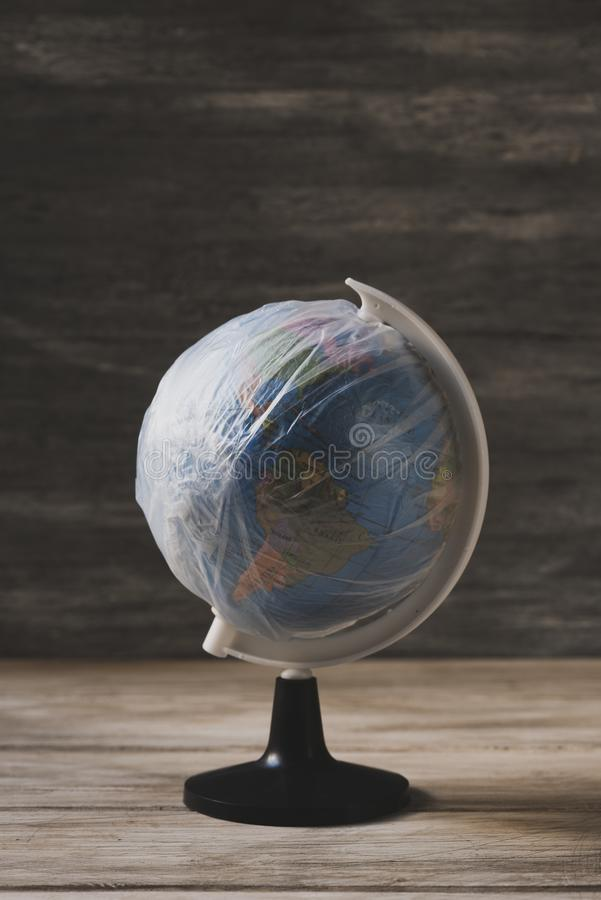 World globe wrapped in plastic stock image