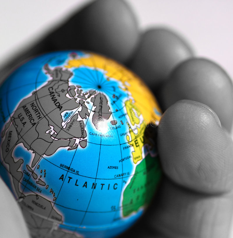 World in a Hand. Small globe held in a hand