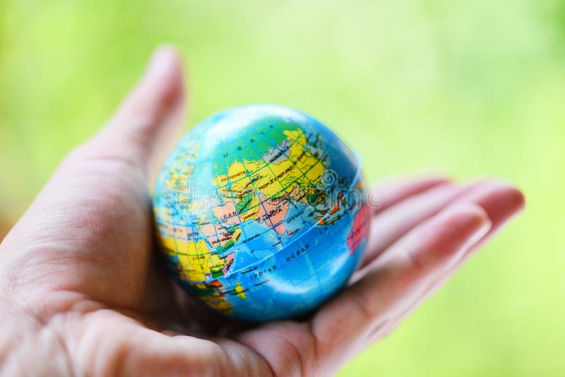 The world in the hand with nature background / hand holding globe with map and environment green planet save the earth stock image