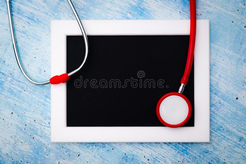 World health day, healthcare and medical concept, red stethoscope and photo frame for copy space royalty free stock photo