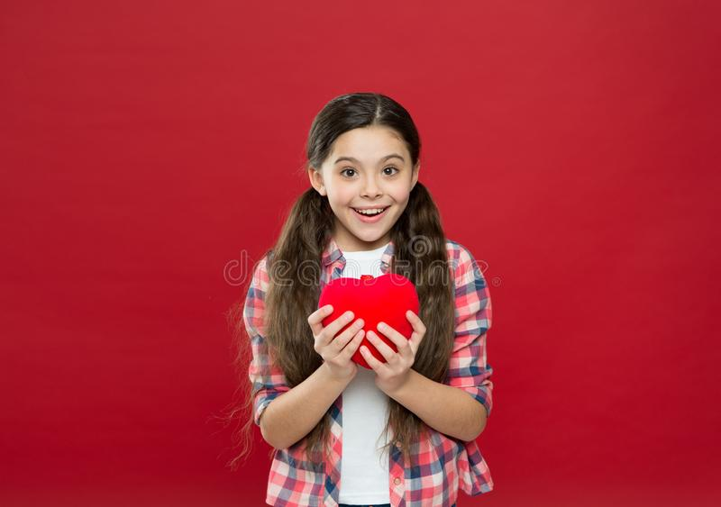 World health day. Little girl holding big red heart. Little child expressing love on valentines day. Cute girl in love royalty free stock photo
