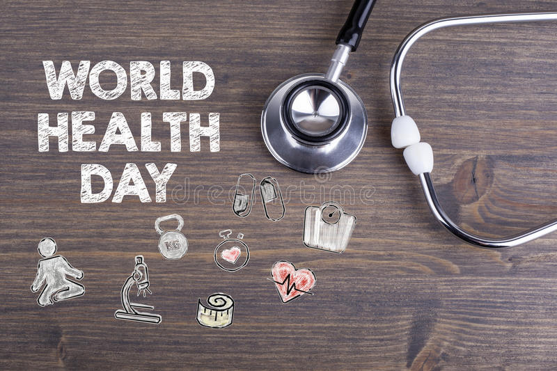World health day. Workplace of a doctor. Stethoscope on wooden desk background royalty free stock images