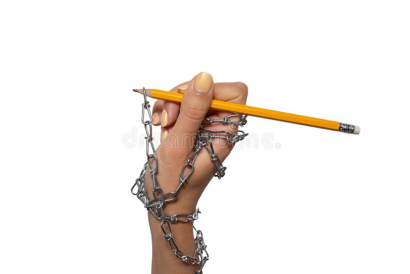 World Information Day -  chained female hand with yellow pencil on the white background royalty free stock images