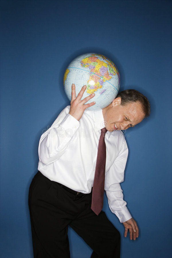 World issues concept. Caucasian middle aged businessman carrying weight of the world on his shoulders stock image