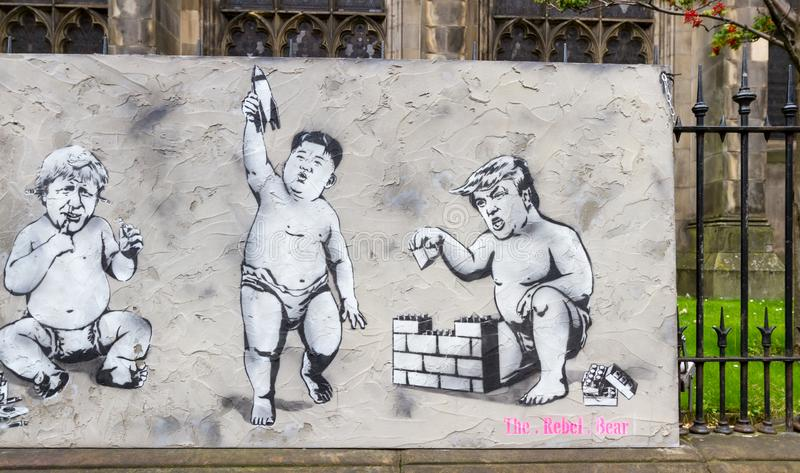 World leaders as toddlers depicted in street art stock photography