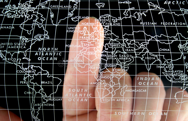 World Map. Map with Finger on the Uk stock images