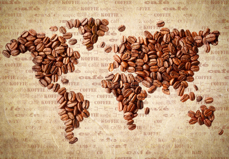 World Map Of Coffee Beans. Fresh roasted coffee beans arranged in the shape of a world map on aged vintage paper with the word coffee in multiple languages royalty free stock photo