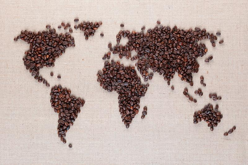 World map from coffee beans on linen canvas royalty free stock images
