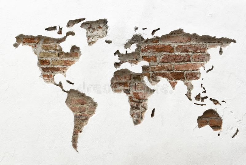 World map with the continents carved in the wall. World map without borders carved on a white wall with the continents royalty free stock photography