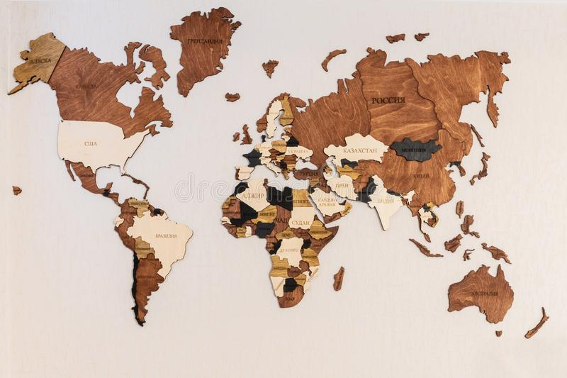 World map of earth showing continents on a wood tree ring textured background on white. Surface, wooden, asia, atlas, brown, business, global, illustration royalty free stock images