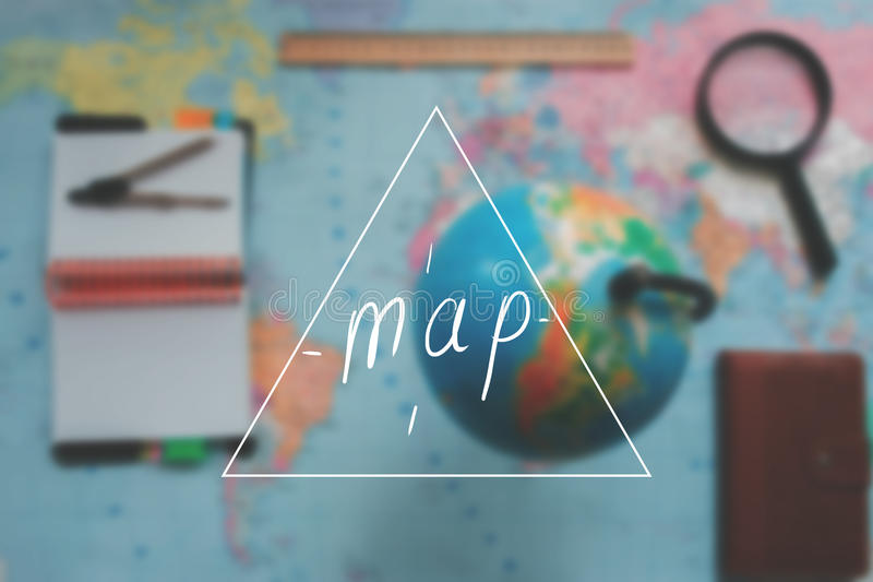 World map with globe blurred background with an inscription. World map with globe blurred background with an inscription stock photography