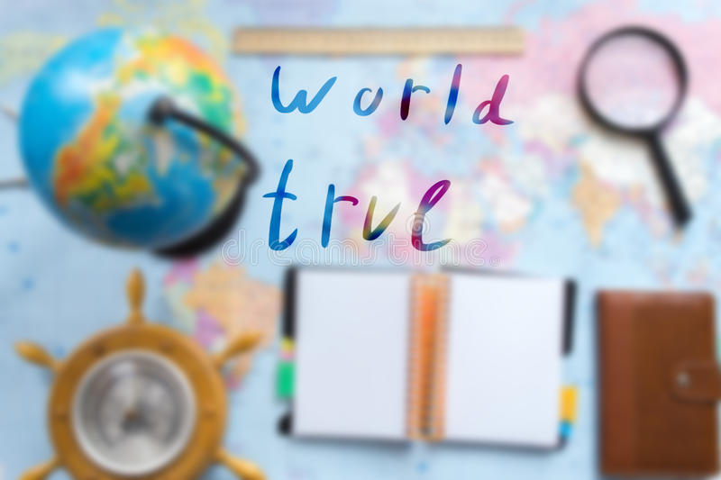 World map with globe blurred background with an inscription. World map with globe blurred background with an inscription stock photo