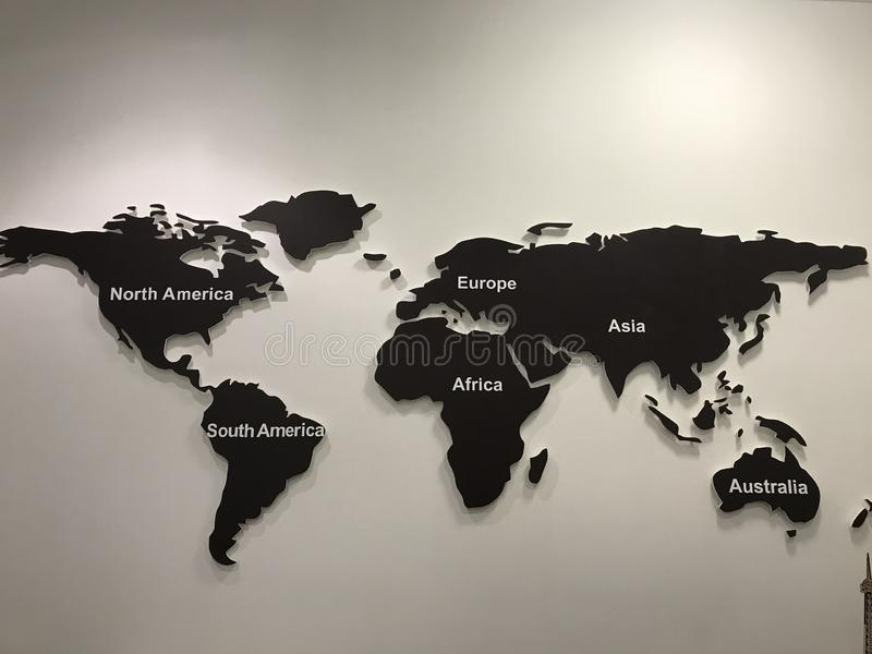 world map on a wall of wood royalty free stock photography