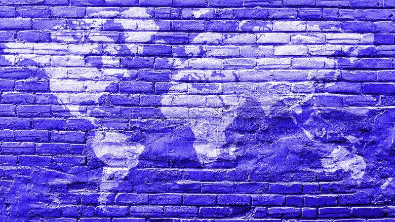 World map in white on vintage blue bricks wall royalty free stock images