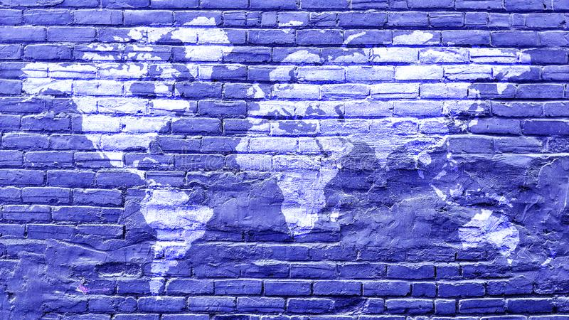 World map in white on vintage blue bricks wall royalty free stock photography