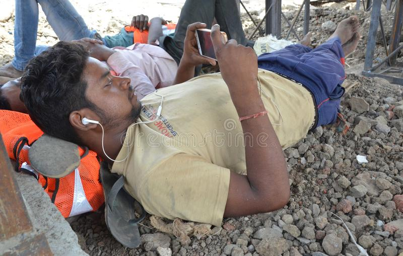 World may day. Construction Labour sleep in a concrete pipe in a very hot day in Bhopal, India stock image