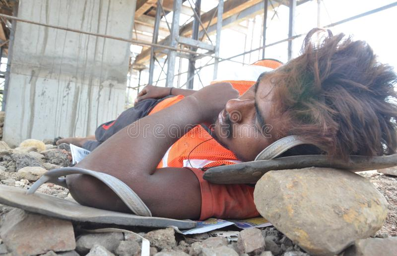 World may day. Construction Labour sleeps in a very hot day in Bhopal, India stock photography