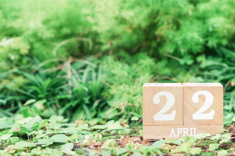 World Mother Earth day background concept. Wooden calendar with date. `22 april ` with green nature background with copy space stock photo