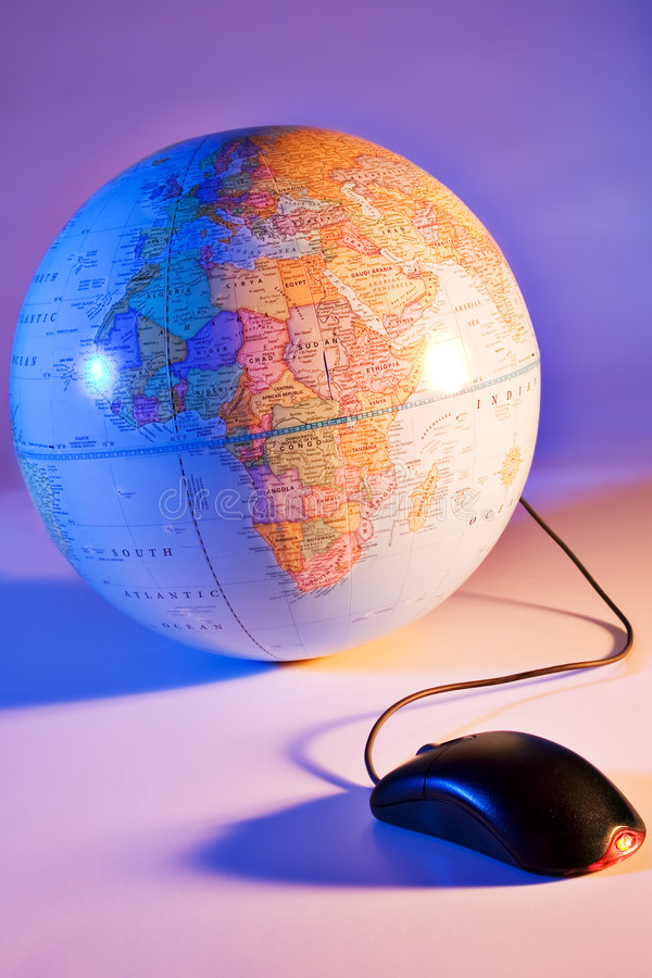 World at a mouse click. Mouse connected to a world globe stock photography