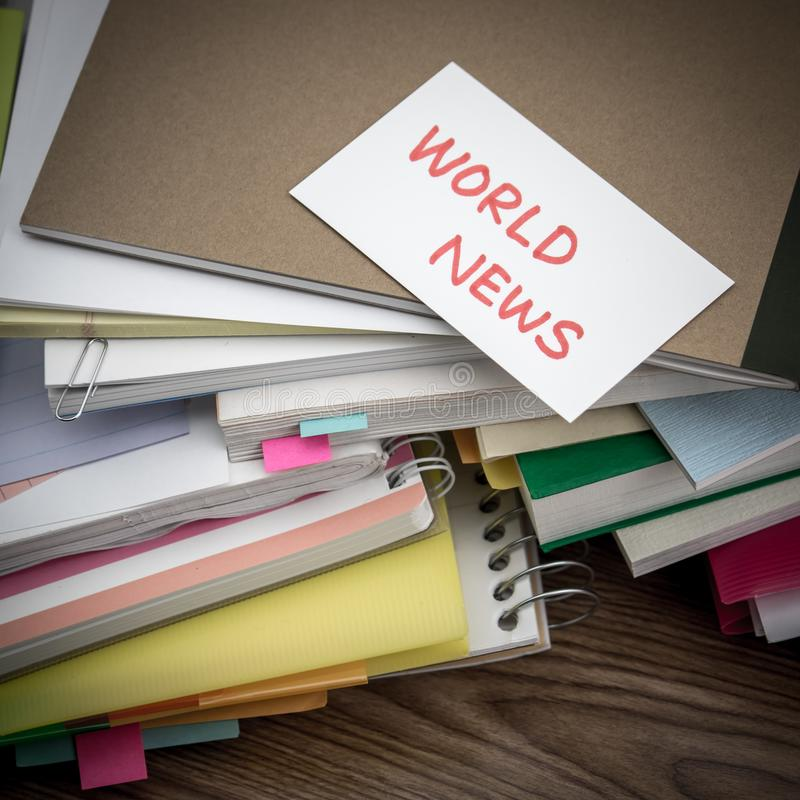World News; The Pile of Business Documents on the Desk.  royalty free stock photos